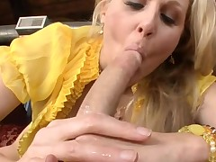 Breasty aged hottie is sucking on dude's jock hungrily