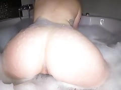 Playing with her own gigantic knockers makes chick very horny